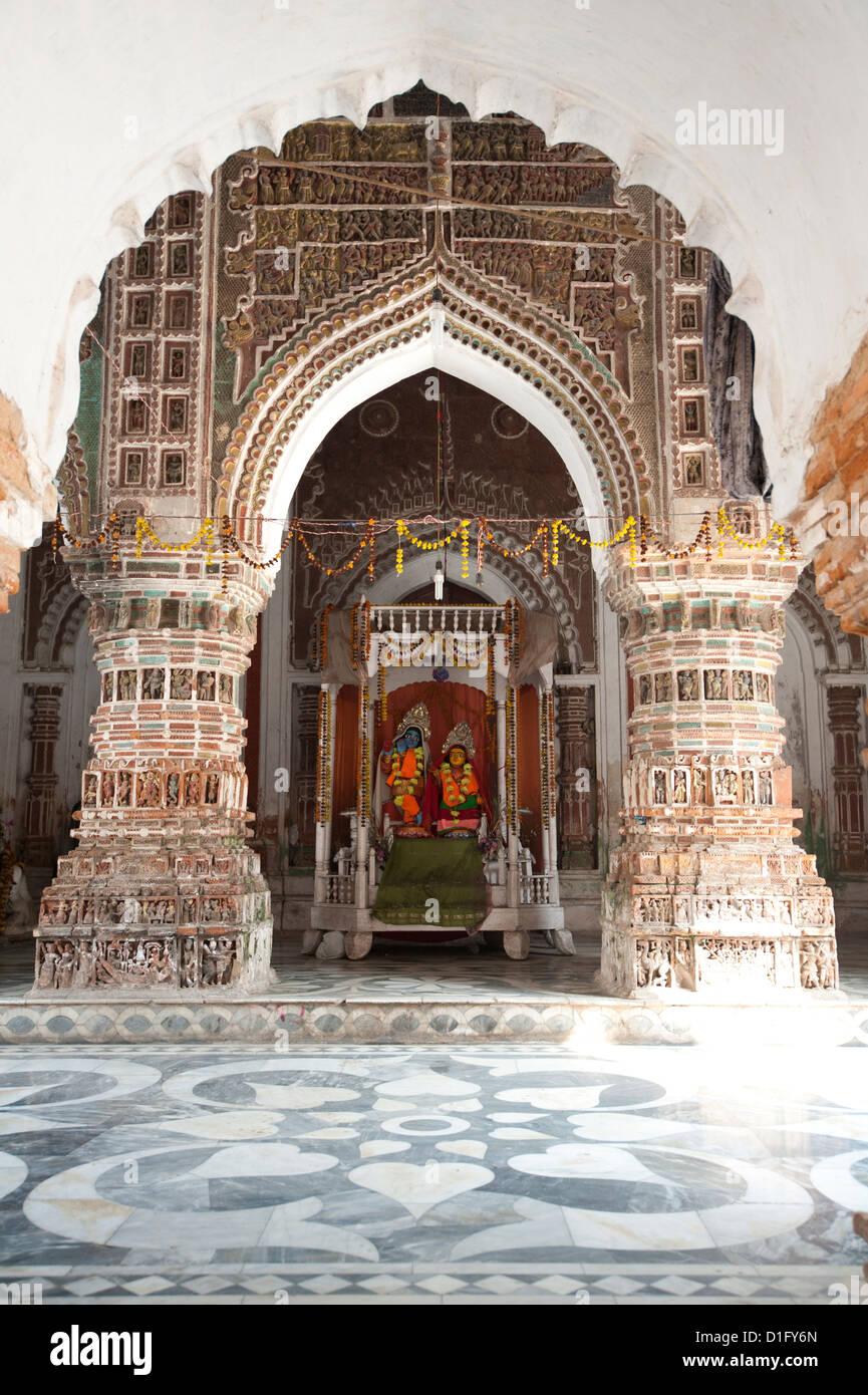 Hindu deities Lord Krishna and Radha in the Lalji Mandir shrine, one of the terracotta temples at Kalna, West Bengal, - Stock Image