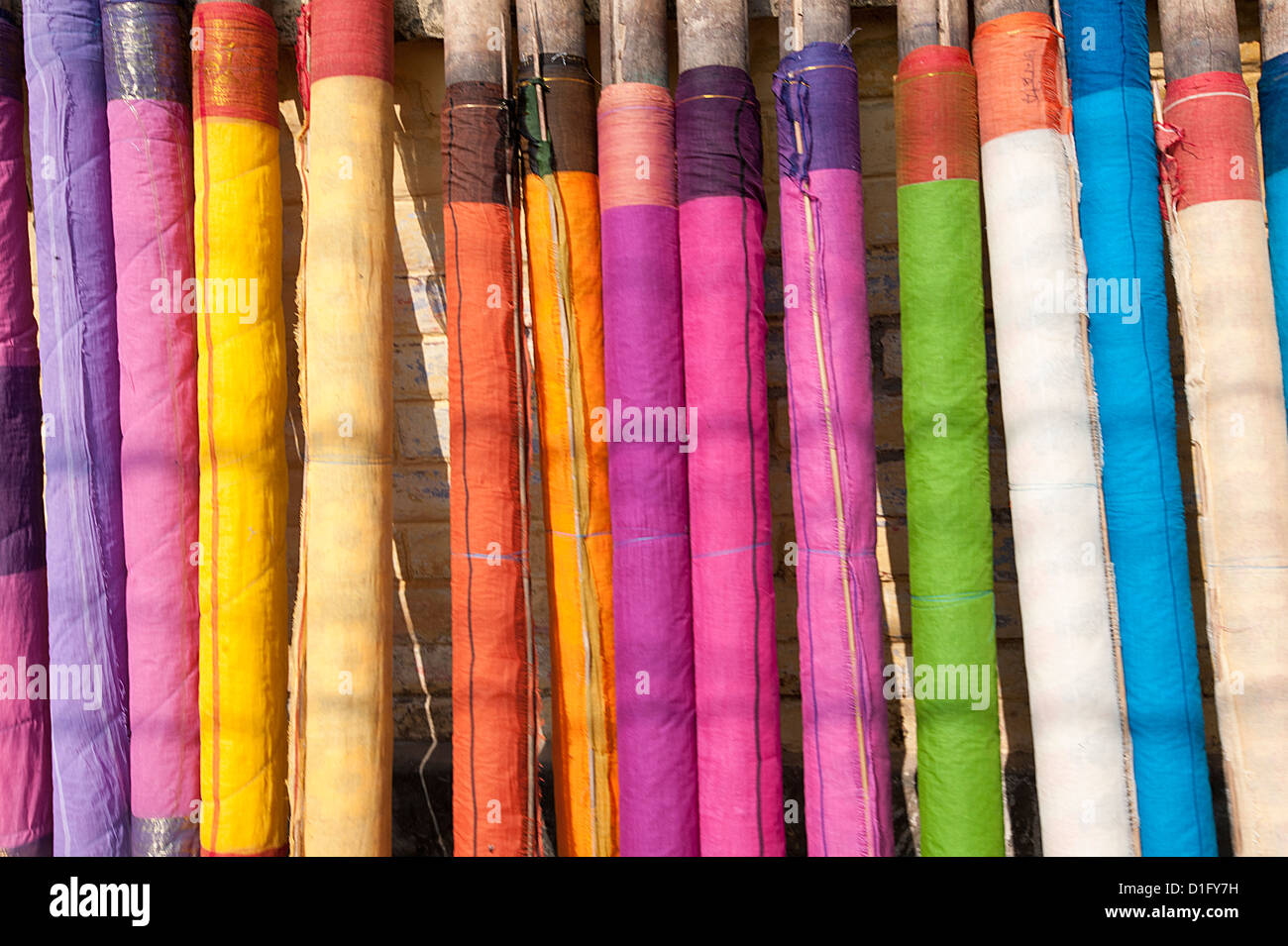 Sari lengths of brightly coloured cotton, hand woven on village looms, Kalna, West Bengal, India, Asia - Stock Image