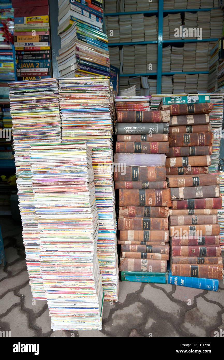 Piles of secondhand books for sale in College Street, famous for its book stalls, North Kolkata, West Bengal, India, - Stock Image