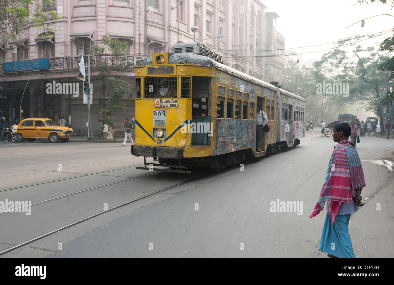 Kolkata traffic including street tram and taxi in the early morning, Kolkata (Calcutta), West Bengal, India, Asia - Stock Image