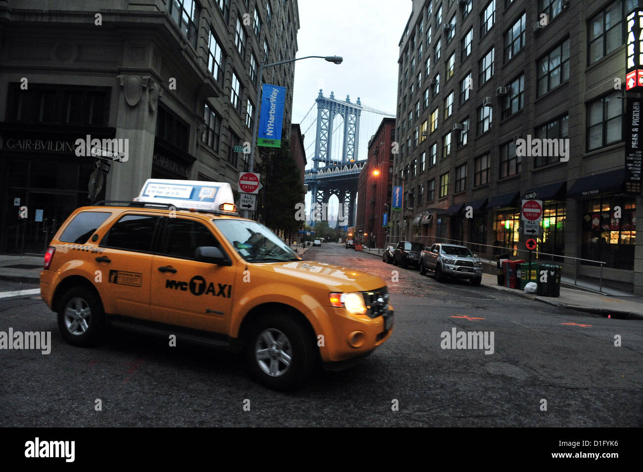The new hybrid Yellow taxicab in Manhattan New York. - Stock Image