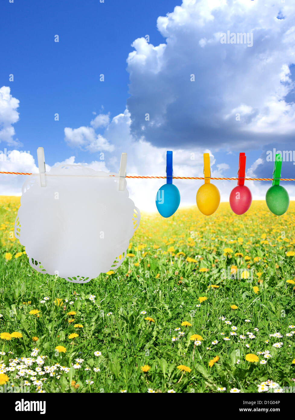 Colorful easter eggs creative concept hanging on a string - Stock Image