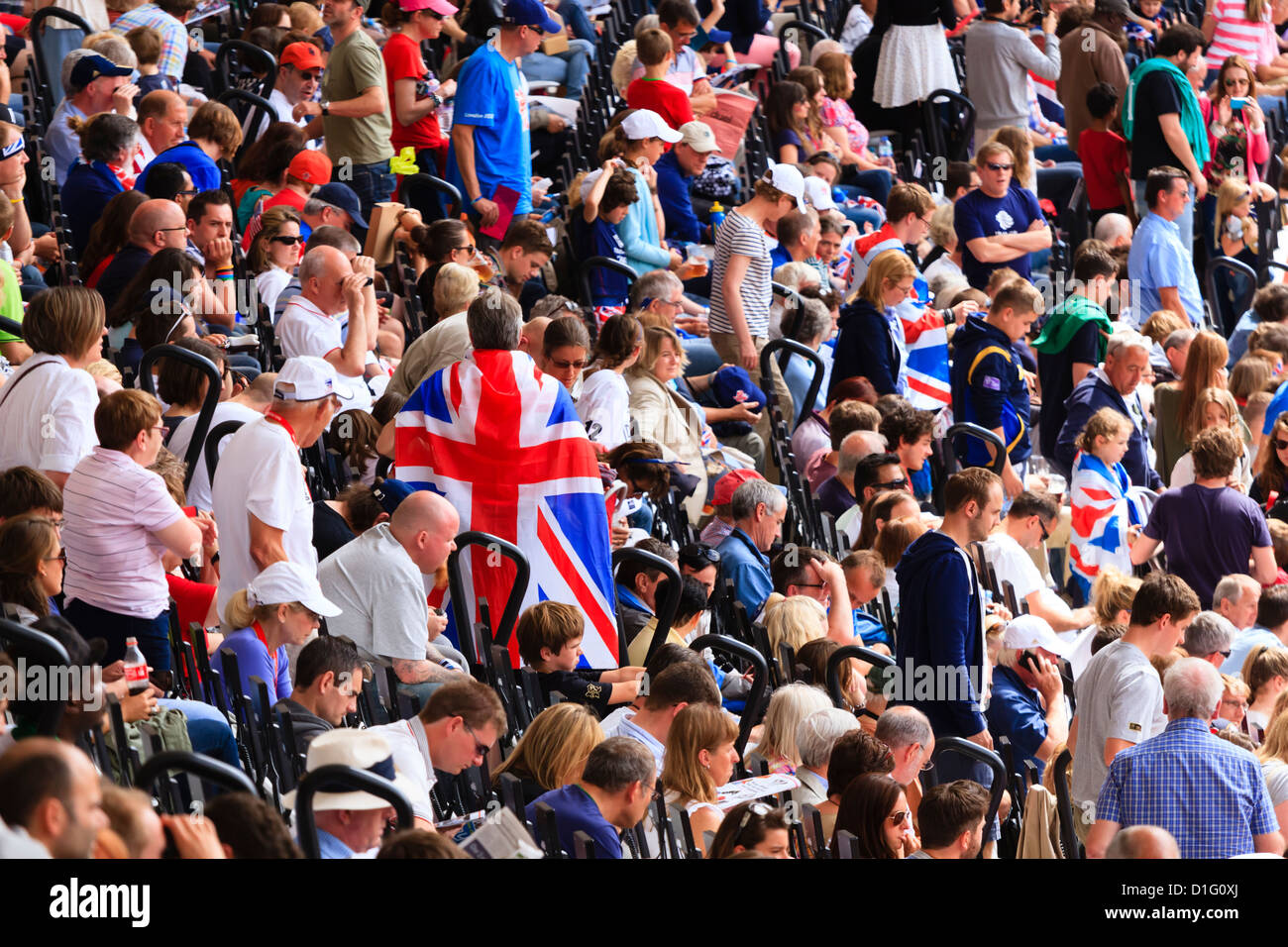 Crowd of British spectators with Union flags in a sports arena, London, England, United Kingdom, Europe - Stock Image