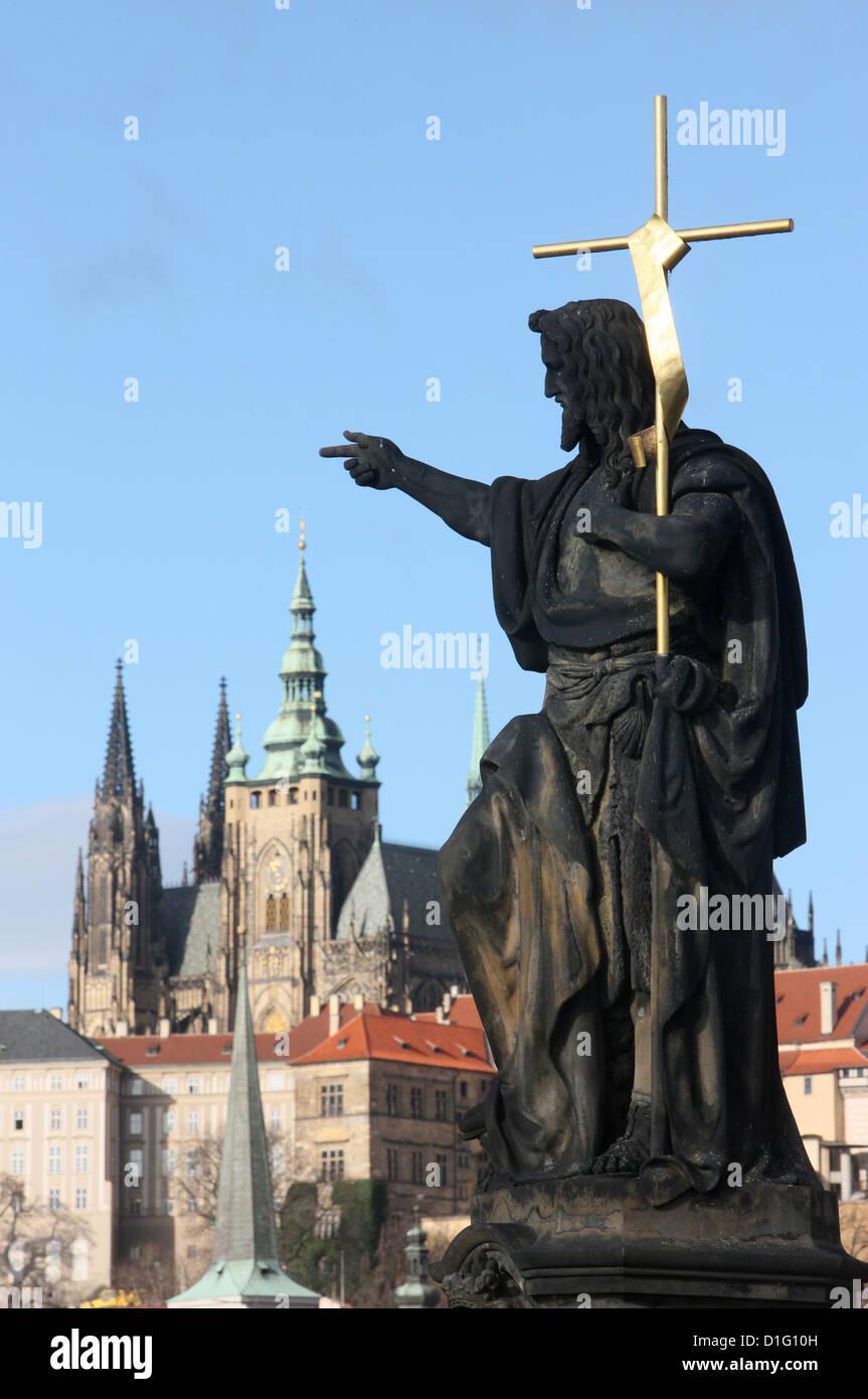 St. John the Baptist sculpture on Charles Bridge, UNESCO World Heritage Site, Prague, Czech Republic, Europe - Stock Image