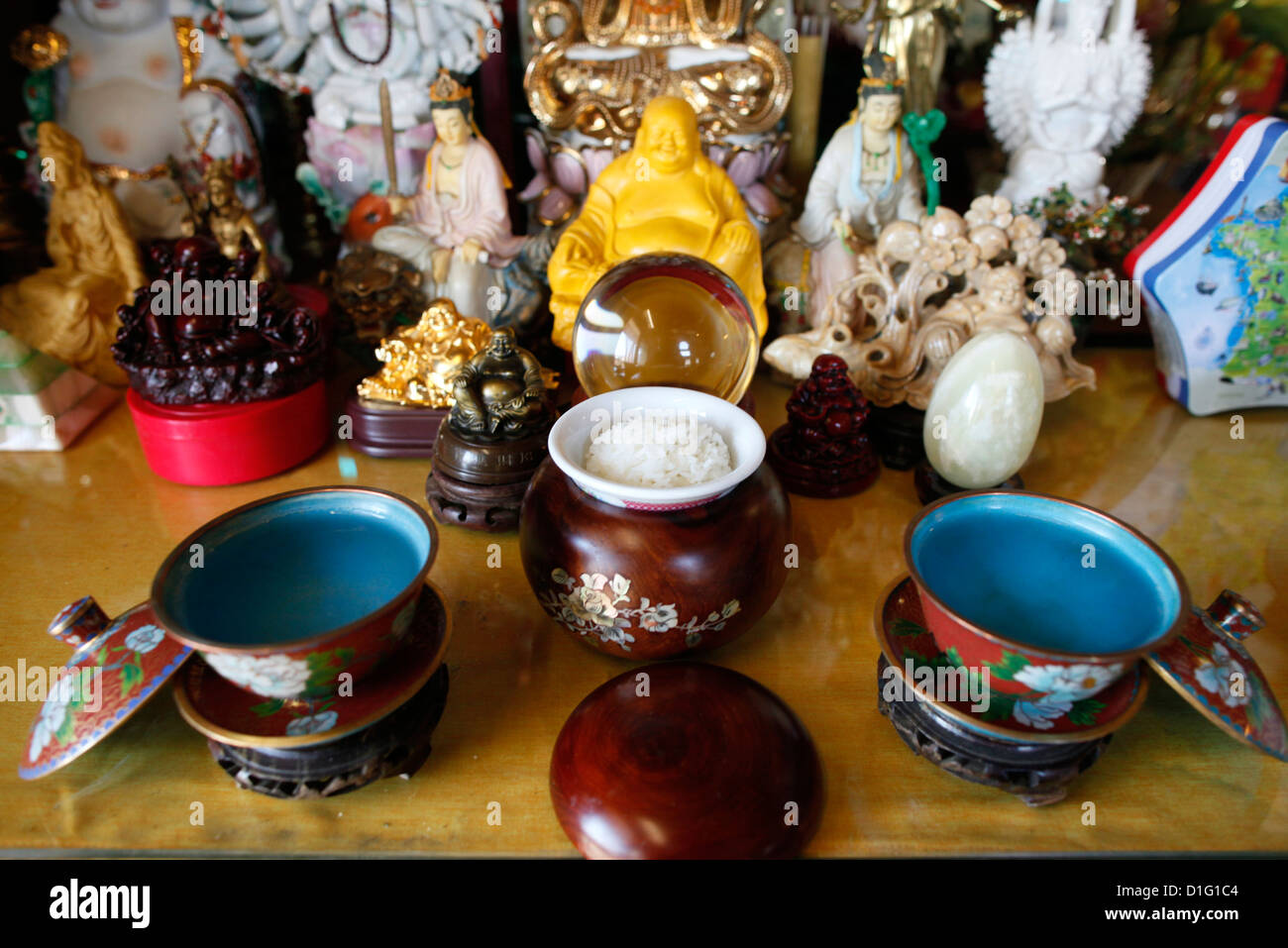 Cups containing holy water, Buddhist altar, Tu An Buddhist temple, Saint-Pierre-en-Faucigny, Haute Savoie, France, - Stock Image