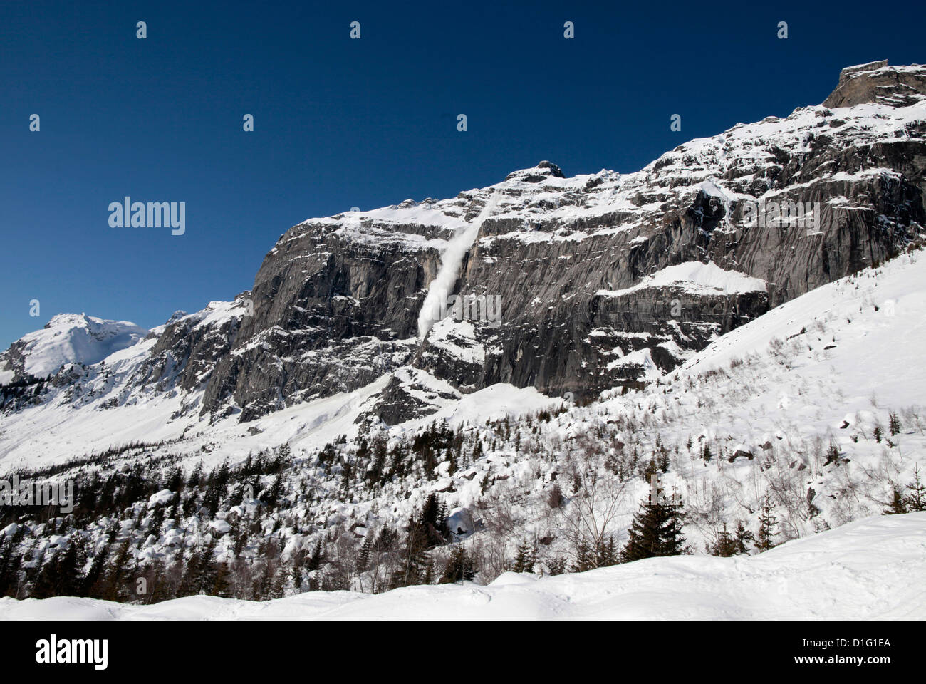 Snow-covered rocks in the French Alps, Plateau d'Assy, Haute-Savoie, France, Europe - Stock Image