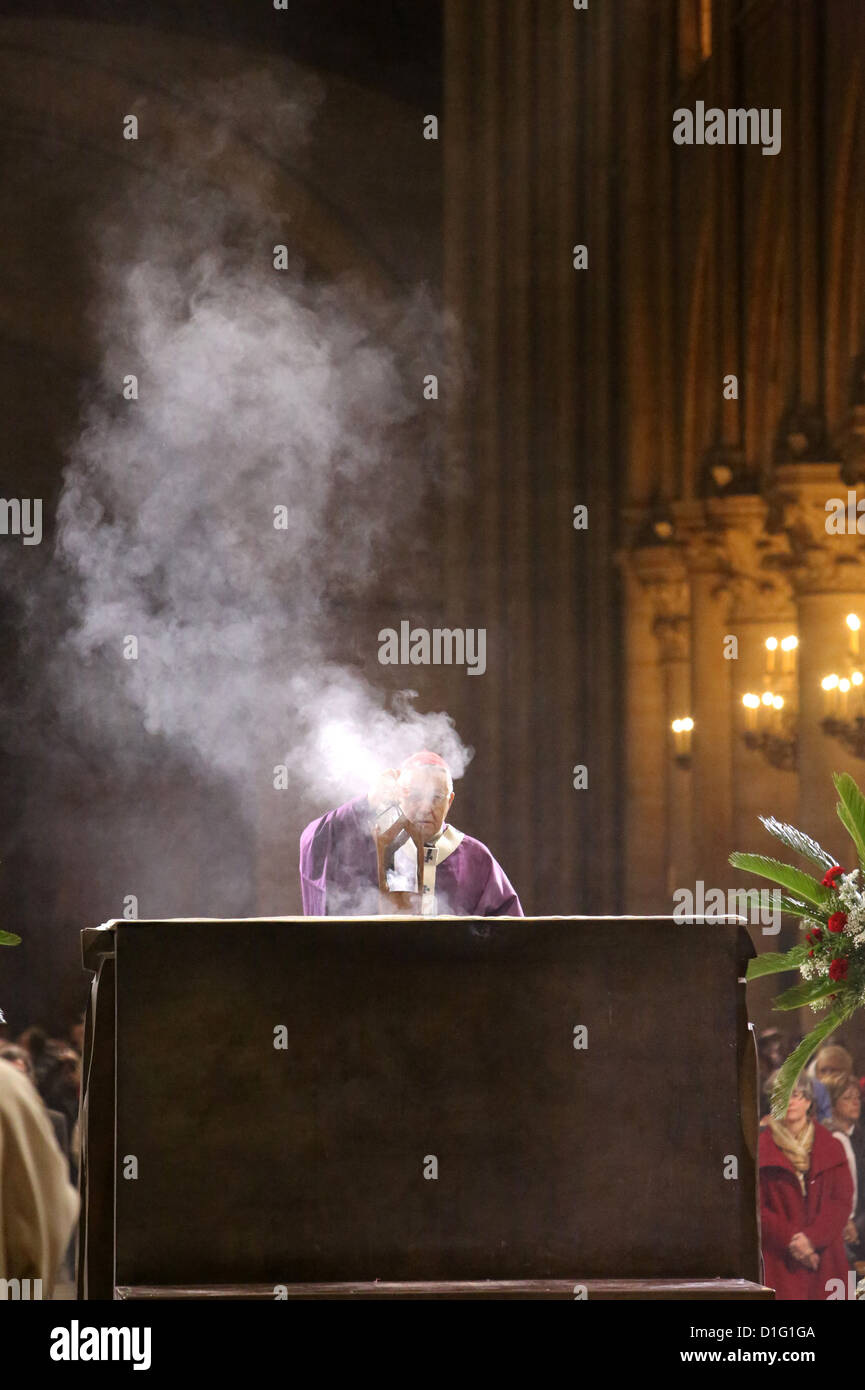 Archbishop censing the altar of Notre Dame Cathedral, Paris, France, Europe - Stock Image