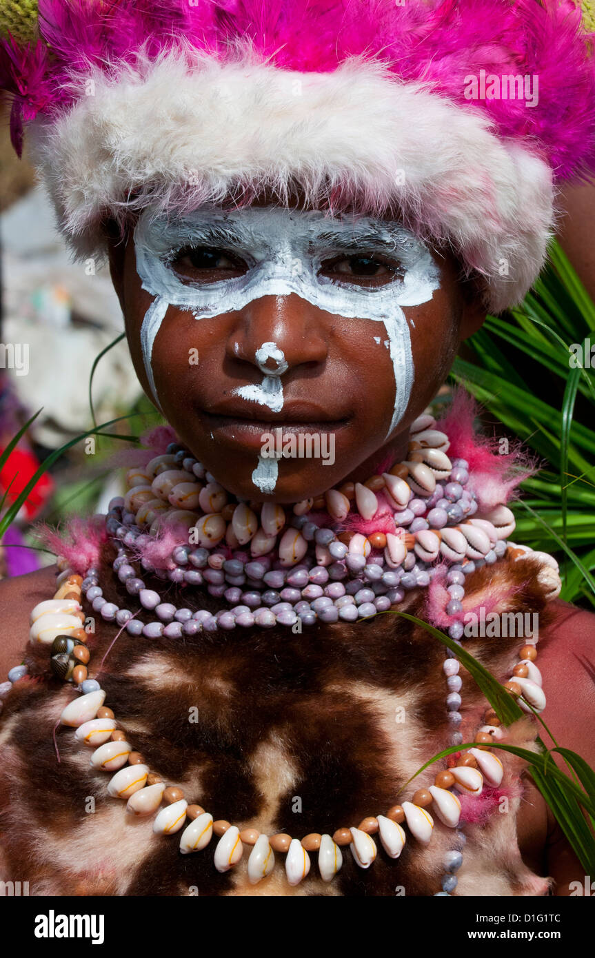 Child of a local tribe celebrating the traditional Sing Sing in the Highlands, Papua New Guinea - Stock Image
