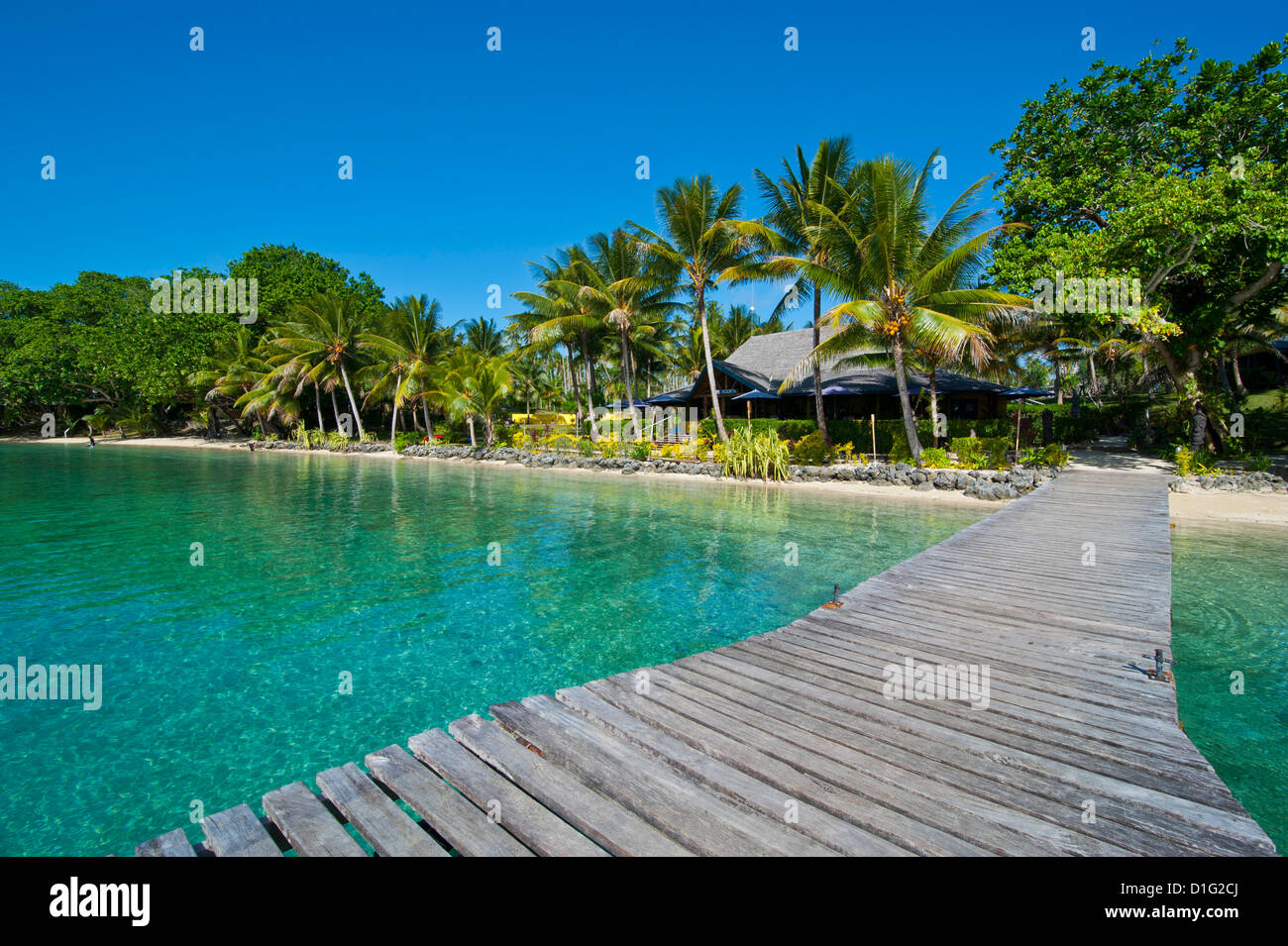 Wooden pier leadin to a resort on Aore islet before the Island of Espiritu Santo, Vanuatu, South Pacific, Pacific - Stock Image