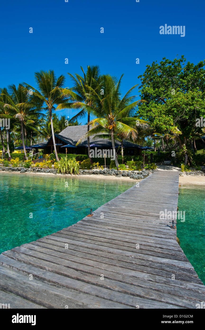 Wooden pier leading to a resort on Aore islet before the Island of Espiritu Santo, Vanuatu, South Pacific, Pacific - Stock Image