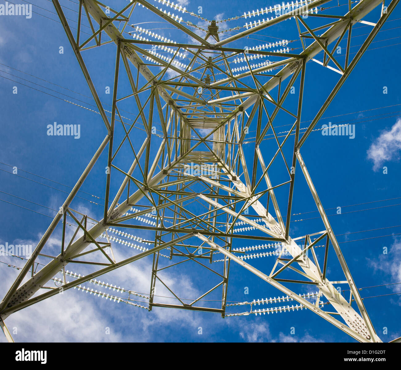 Vertical view through the central axis of an electricity pylon - carrying electricity as part of the UK National - Stock Image