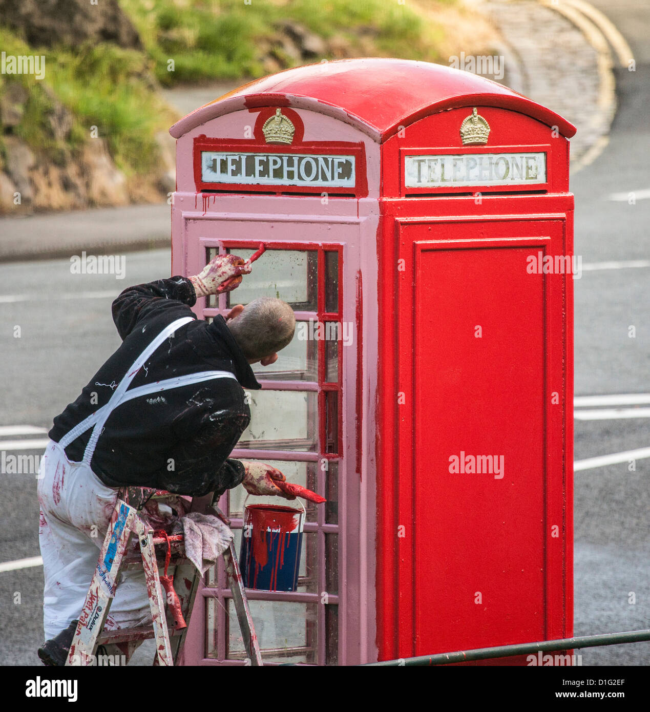Painting a British listed K6 telephone box in Clifton Bristol UK Stock Photo