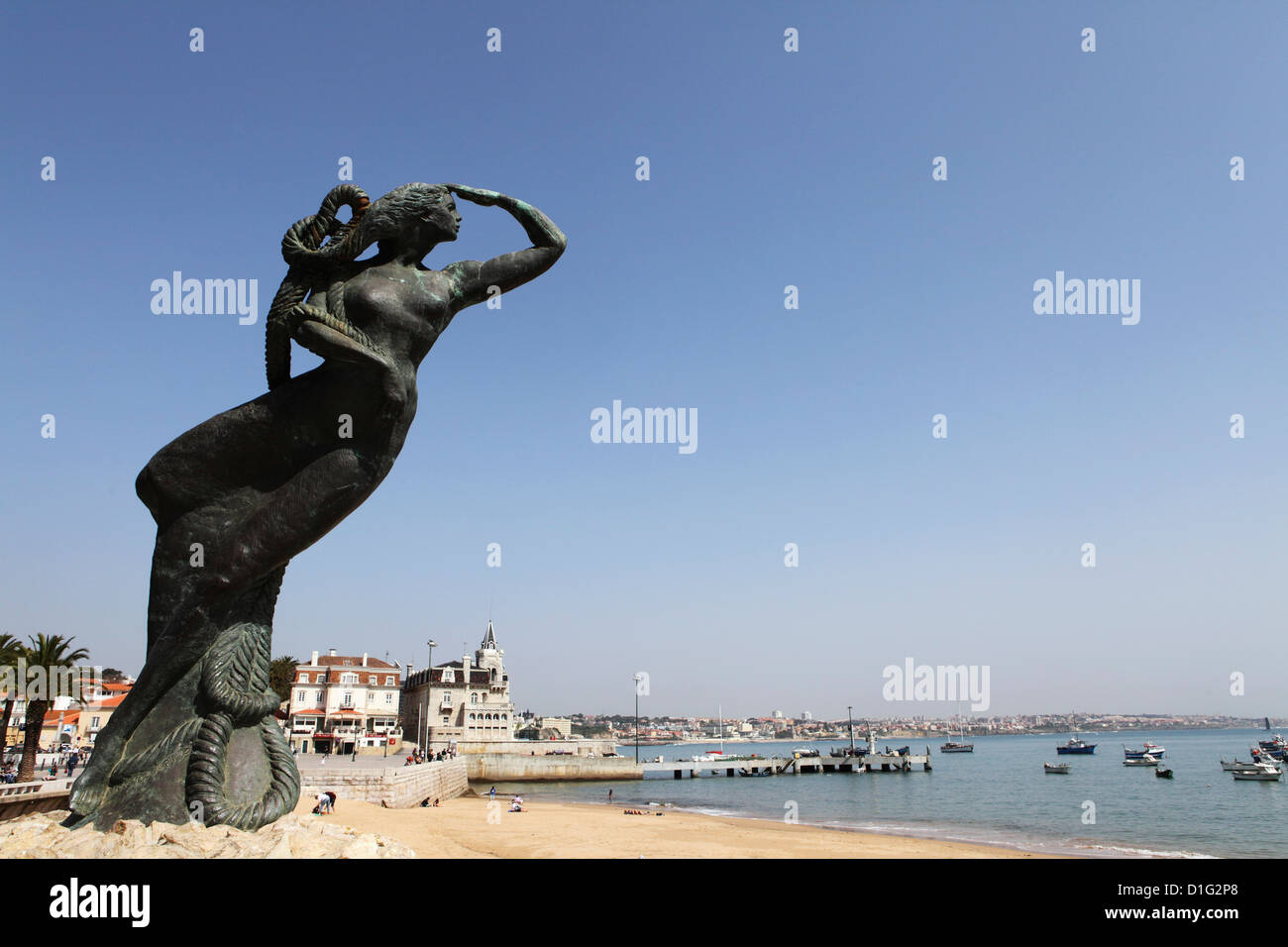 Nautical statue of a female figure looking towards the Atlantic Ocean at Ribeira Beach, Cascais, near Lisbon, Portugal, - Stock Image