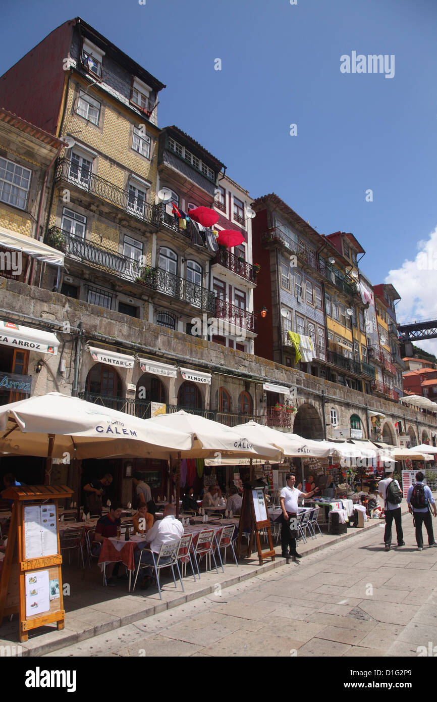 Cafes and restaurants by the Douro riverside in the Ribeira District, UNESCO World Heritage Site, Porto, Douro, - Stock Image