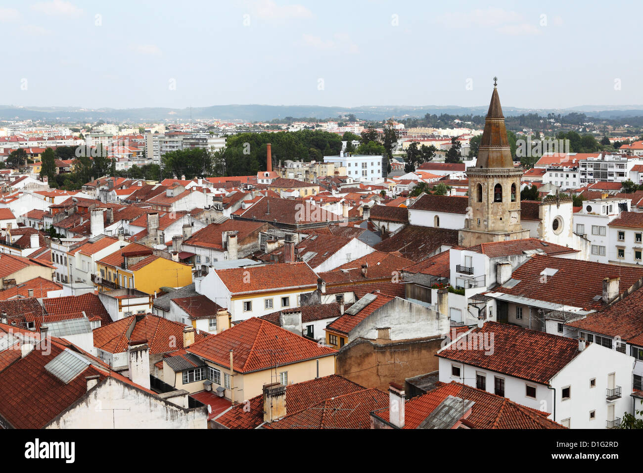 Roofs and the octagonal spire of the Church of St. John the Baptist (Sao Joao Baptista) in the city of Tomar, Ribatejo, - Stock Image