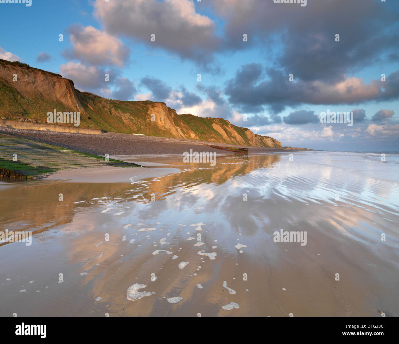 A beautiful sunny morning view of the cliffs at Sheringham, Norfolk, England, United Kingdom, Europe - Stock Image