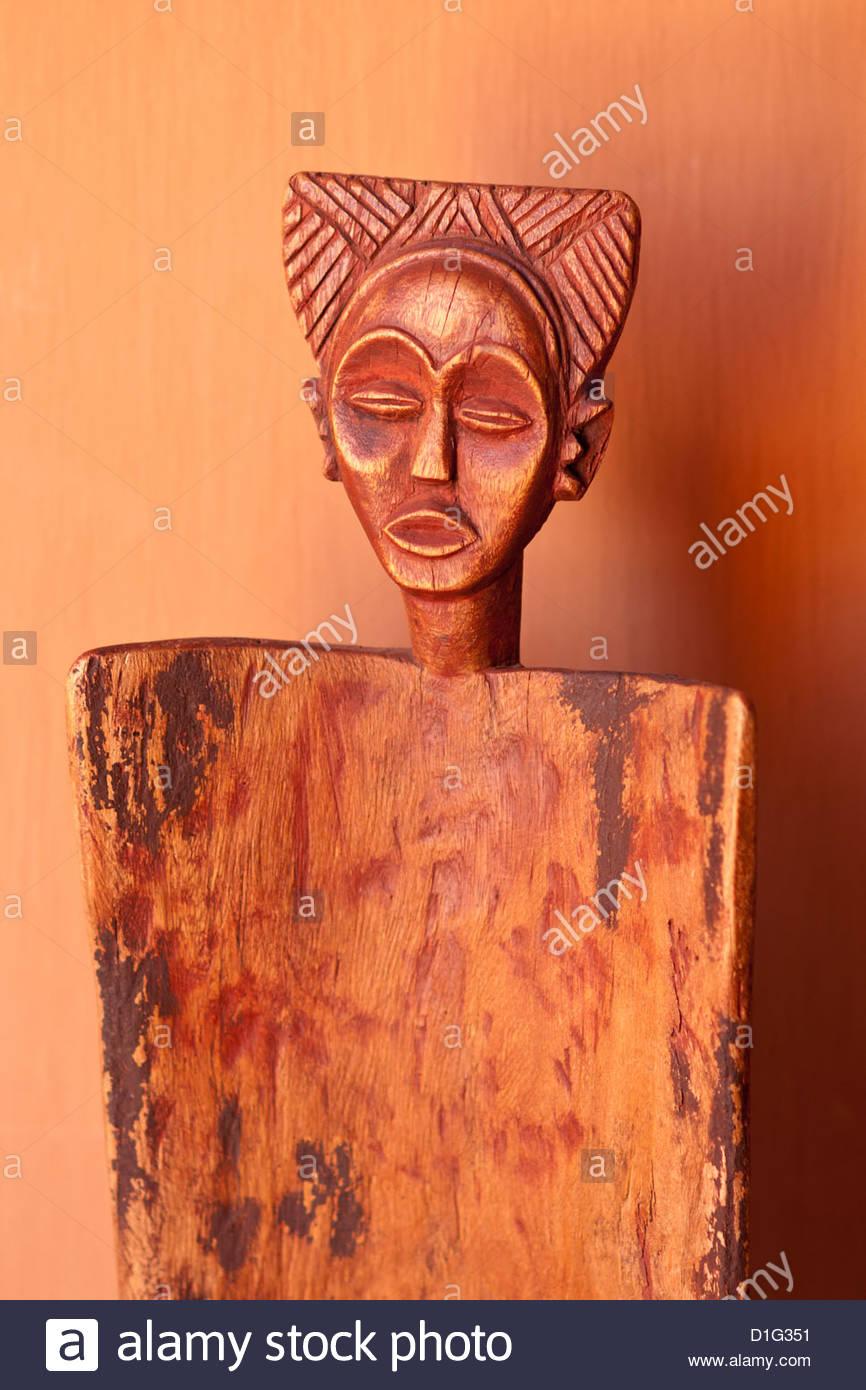 Local artwork depicting female faces, Okahirongo Lodge, Namibia, Africa - Stock Image