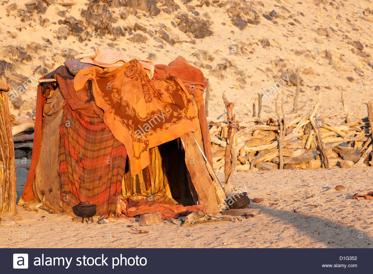 Himba hut covered with patterned blankets, Purros Himba village, northern Namibia, Africa - Stock Image
