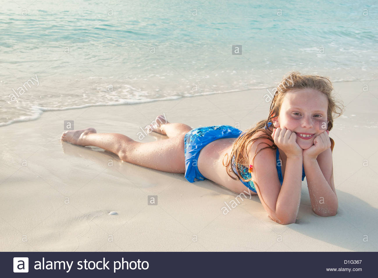 Girl Lying In Sand At Grace Bay Beach Providenciales