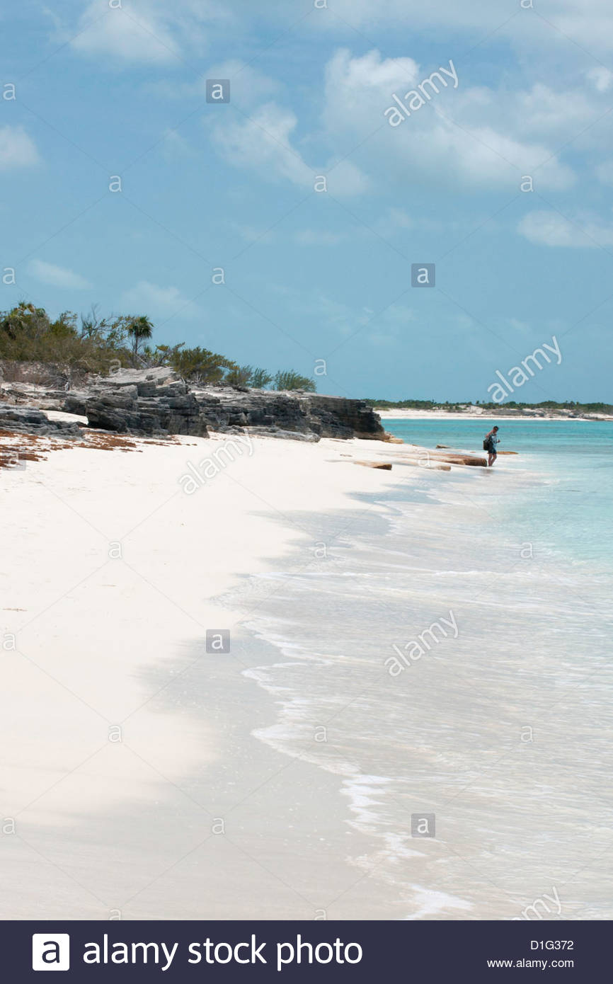 Lone person on a deserted island (cay), eastern Providenciales, Turks and Caicos Islands, West Indies, Caribbean - Stock Image