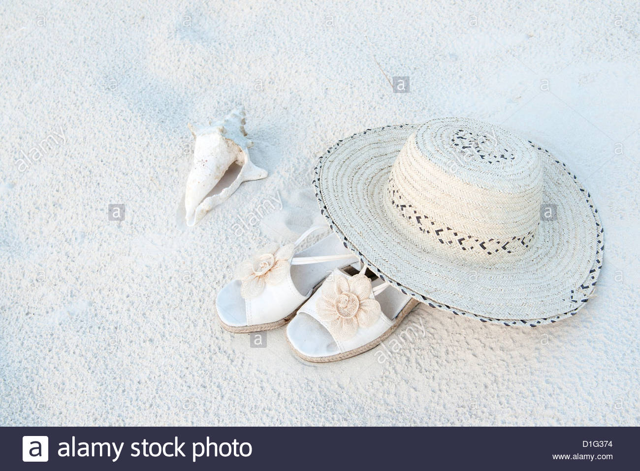 Cream-colored hat and shoes in sands at Grace Bay Beach, Providenciales, Turks and Caicos Islands, West Indies, - Stock Image