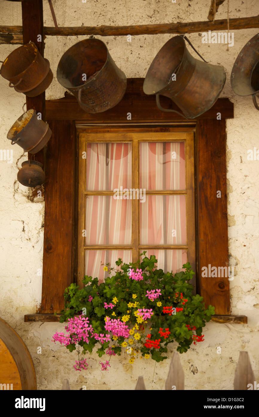 Shuttered windows and flowers, Corvara, Badia Valley, Bolzano Province, South Tyrol, Italian Dolomites, Italy - Stock Image