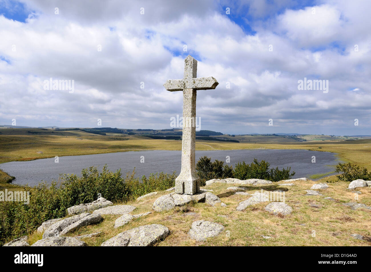 Cross at St Andeol lake on the Way of St James in Lozere, Aubrac, France, Europe - pilgrimage route to Santiago - Stock Image
