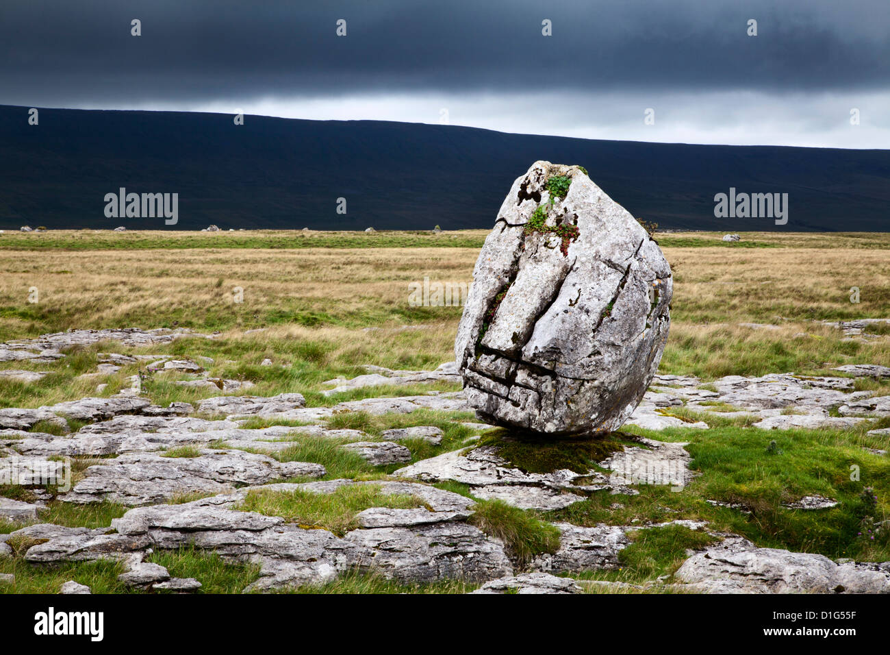 Dark clouds and Standing Stone on Twisleton Scar, Yorkshire Dales, North Yorkshire, Yortkshire, England, United - Stock Image