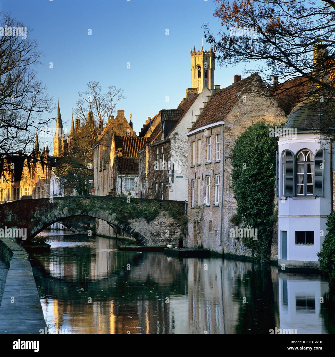 Canal view with Belfry in winter, Bruges, West Vlaanderen (Flanders), Belgium, Europe - Stock Image