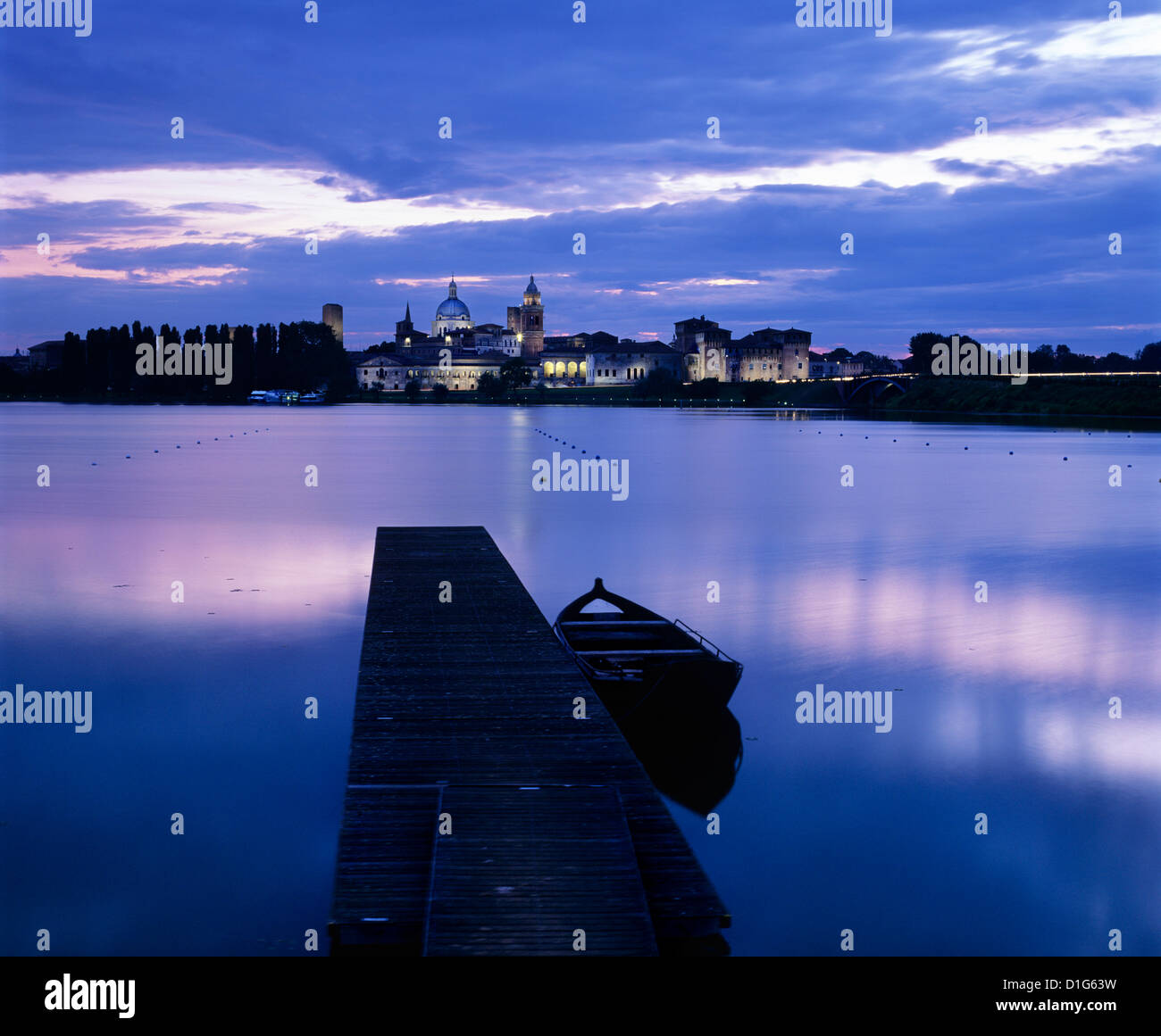 Dusk over the old town and Lake Inferiore, Mantua, Lombardy, Italy, Europe - Stock Image