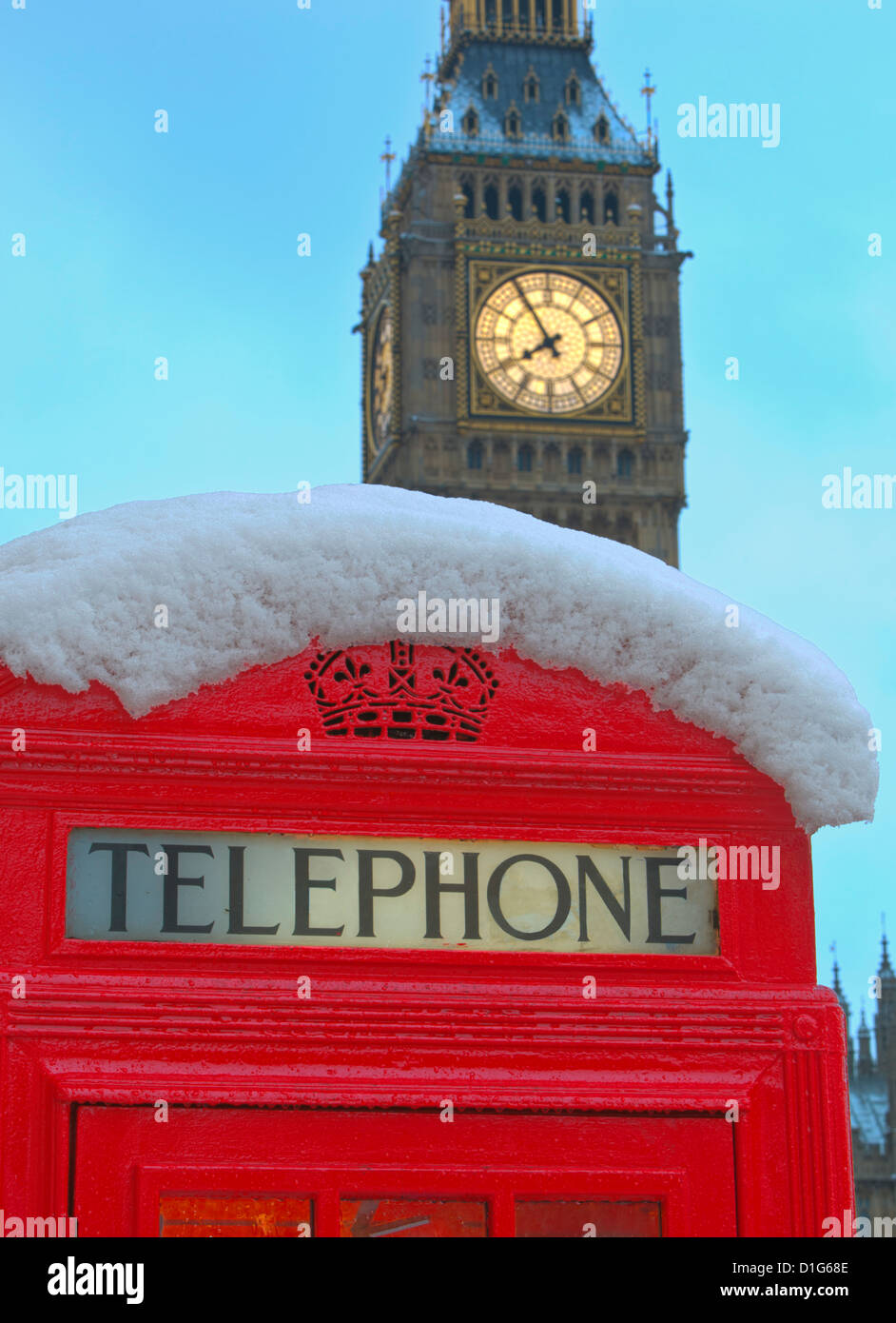 Red phone box and Big Ben in snow, Parliament Square, London, England, United Kingdom, Europe - Stock Image