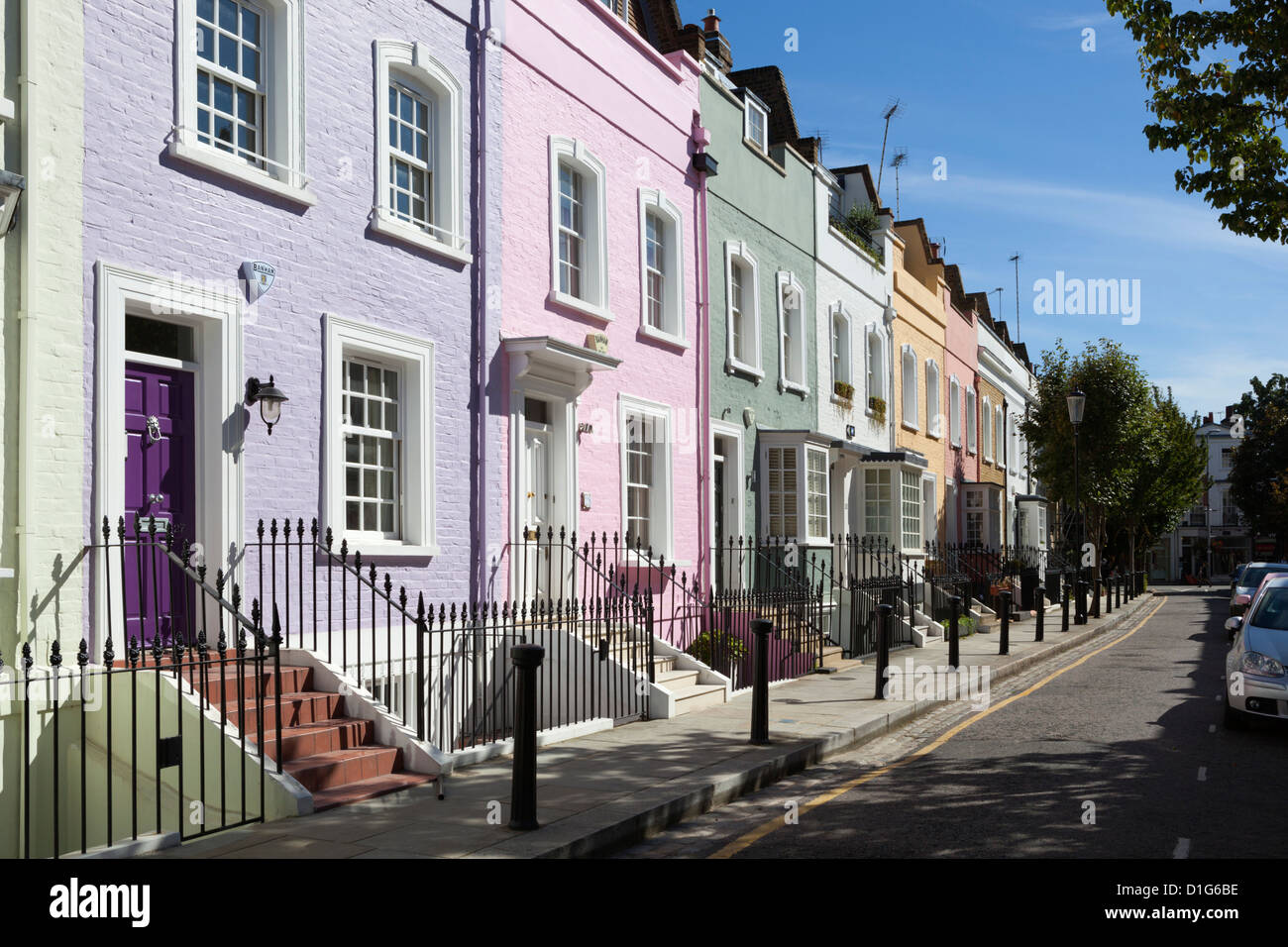 Pastel coloured terraced houses, Bywater Street, Chelsea, London, England, United Kingdom, Europe - Stock Image