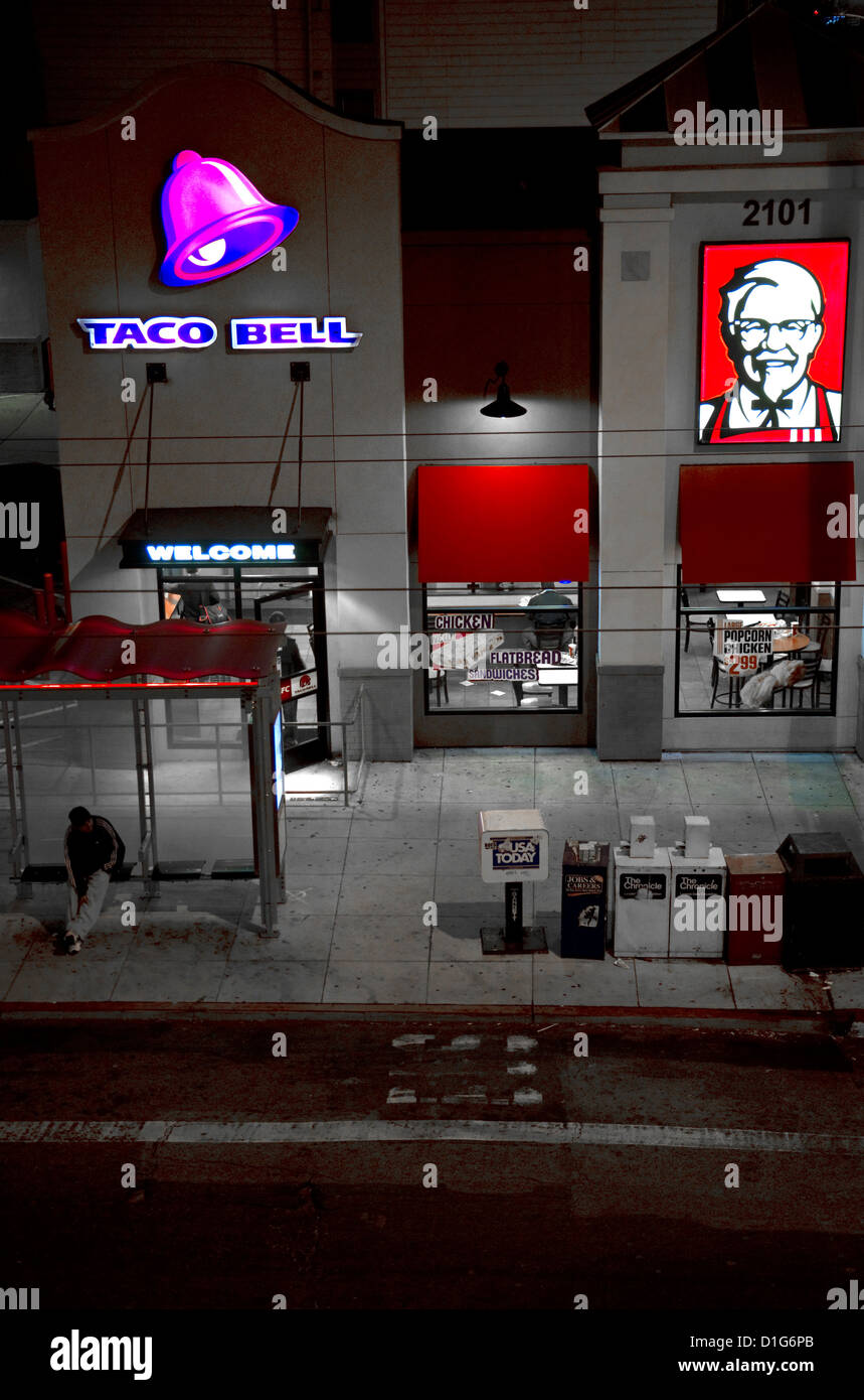 Fast food restaurant combination of Taco Bell and Kentucky Fried Chicken on Lombard Street in San Francisco, California, - Stock Image