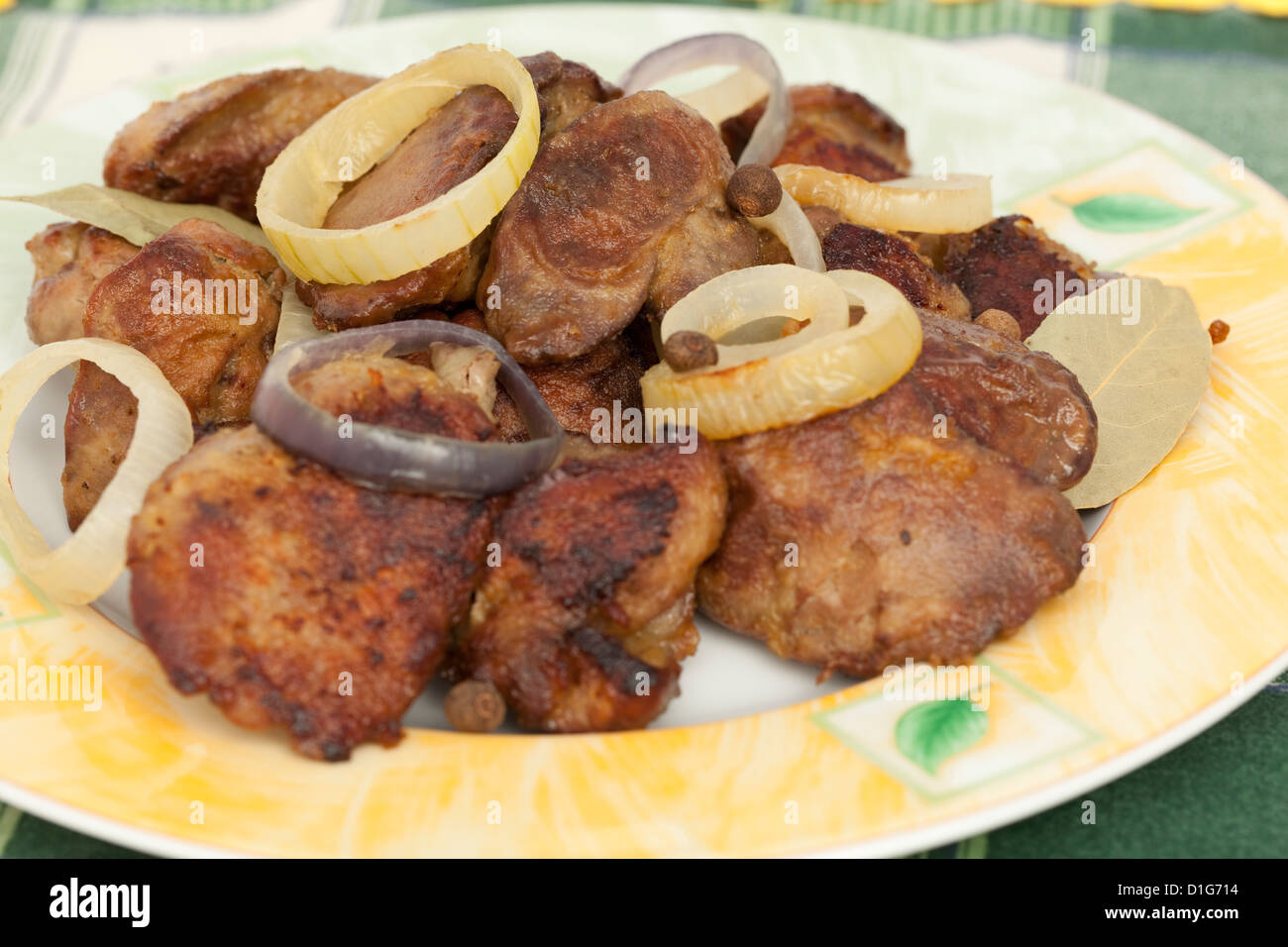 liver with chicken with onion on plate - Stock Image