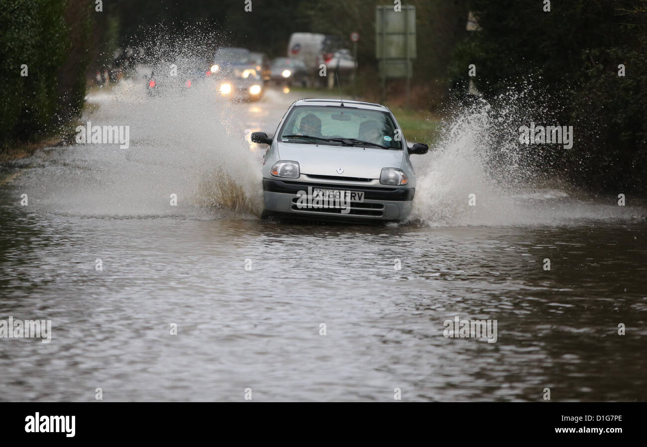 Vehicles negotiate flooded roads near Henfield in West Sussex after torrential rain. Picture by James Boardman - Stock Image