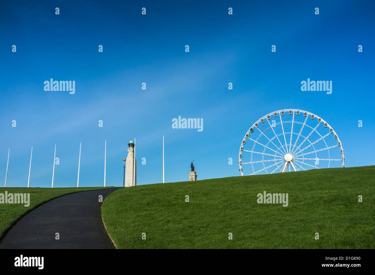 Plymouth Hoe with flagpoles, war memorials and ferris wheel - Stock Image