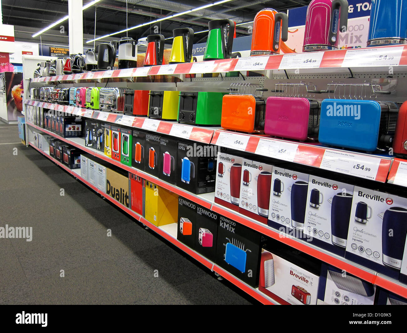 Bright Kitchen Appliances On The Shelves Of An Electrical Store Stock Photo Alamy