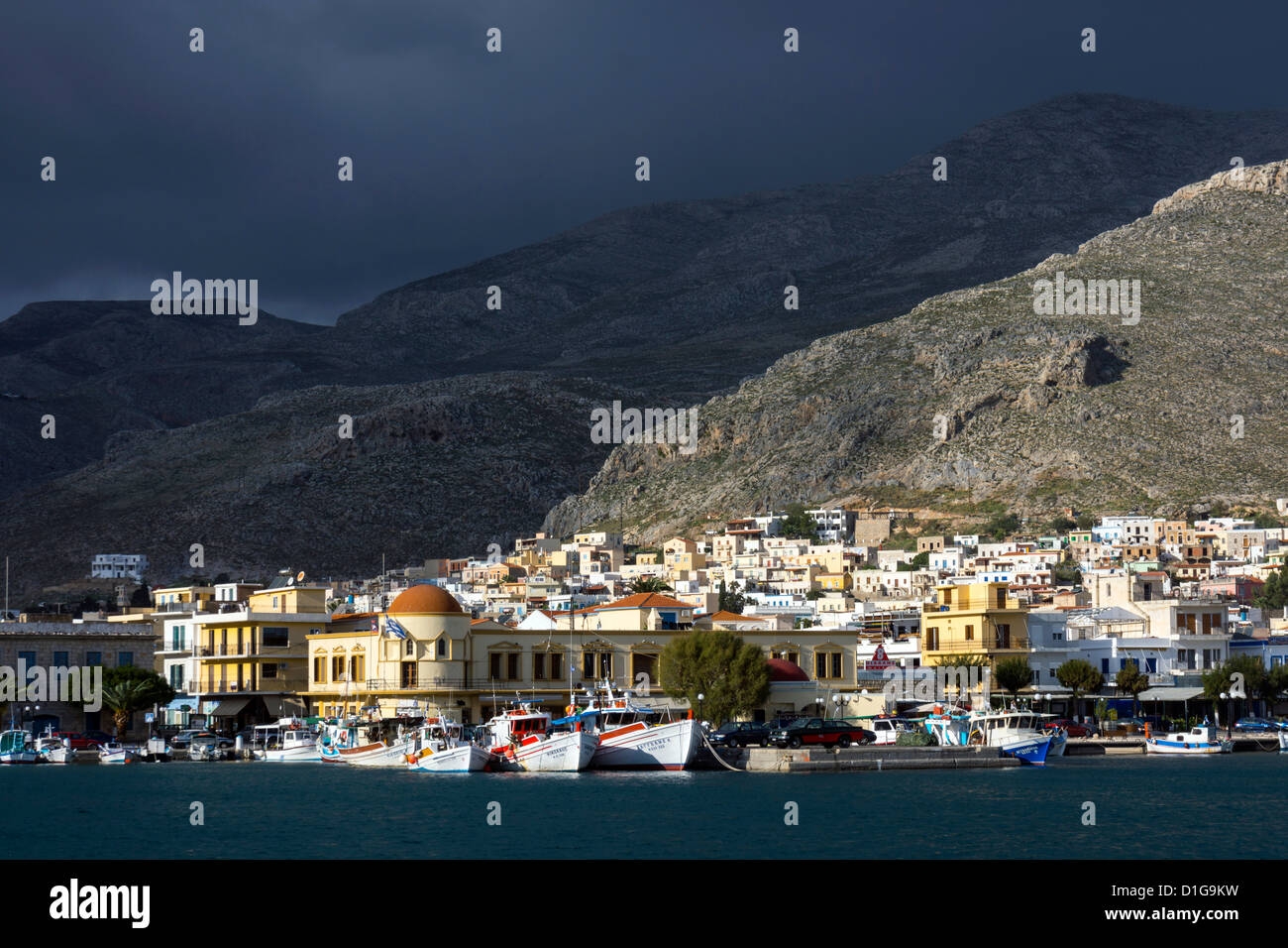Pothia, port town of Kalymnos, with boats and dark skies - Stock Image