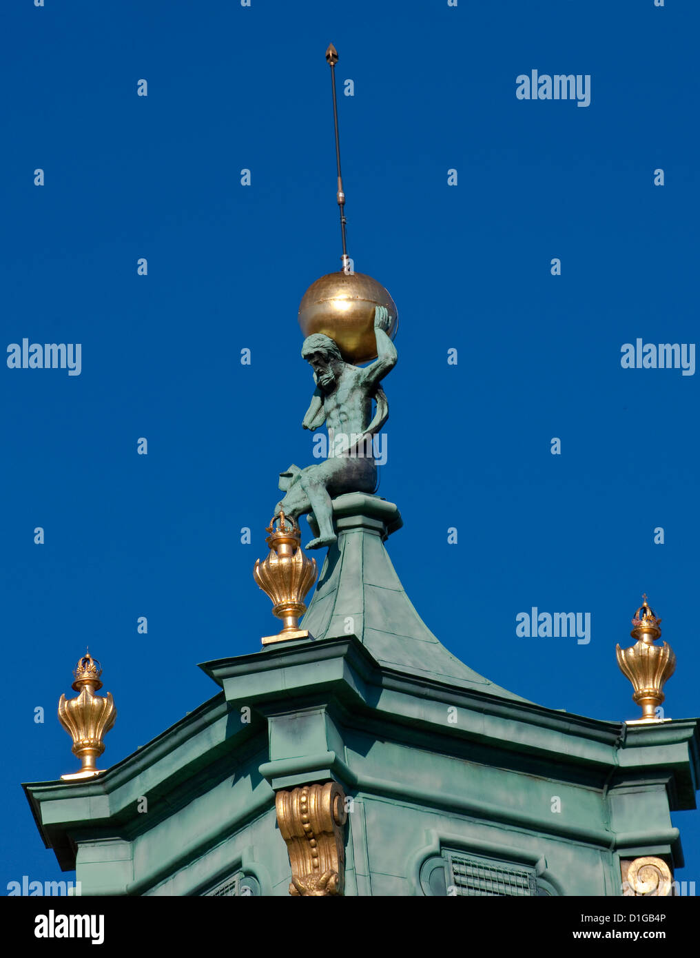 Figure of Atlas holding the celestial sphere at baroque spire on tower at Wilanów Palace in Warsaw, Poland - Stock Image