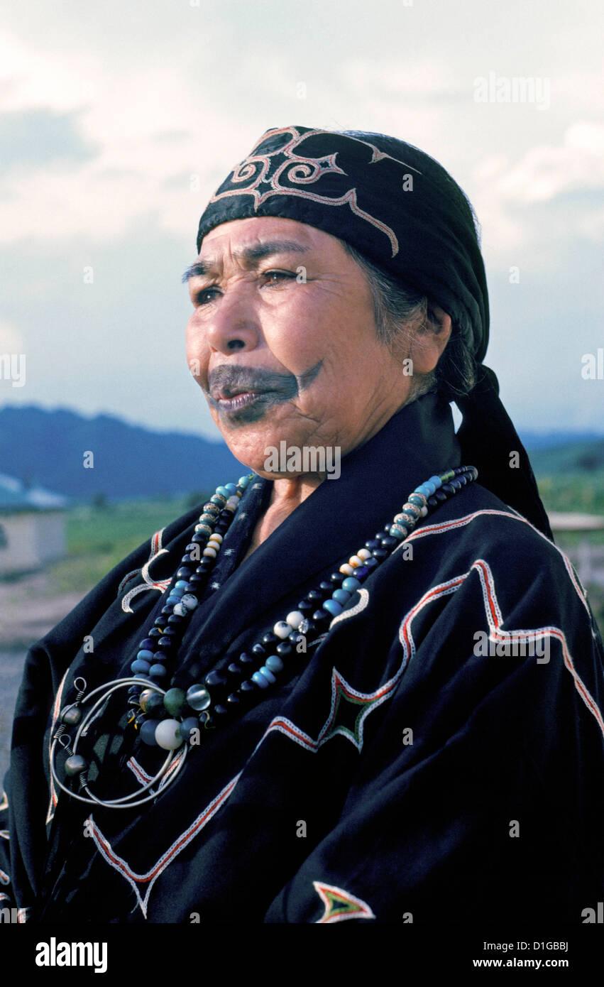 An elderly Ainu woman with a tattoo resembling a mustache ...