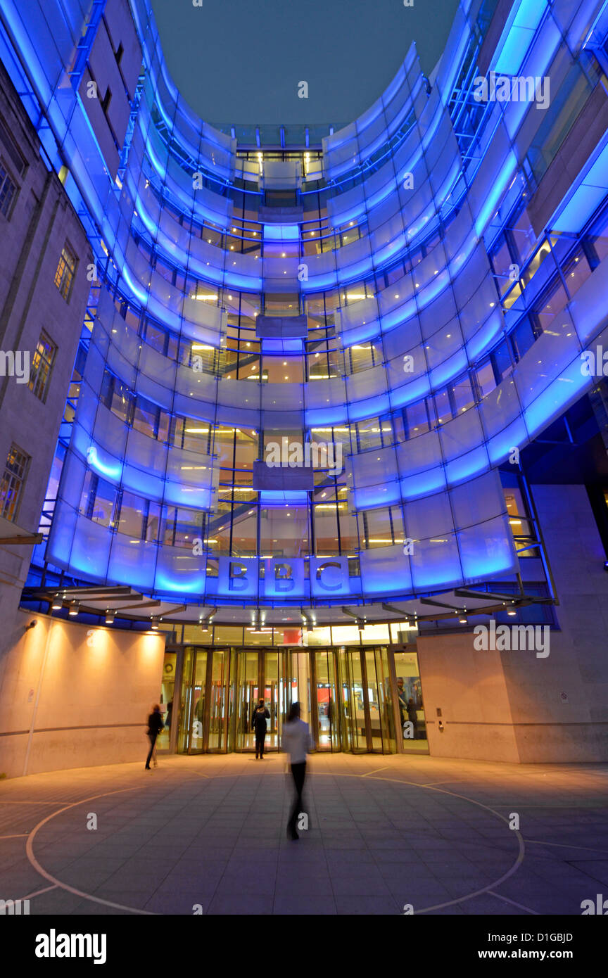 Broadcasting House entrance at night with new east wing extension and BBC logo sign Stock Photo