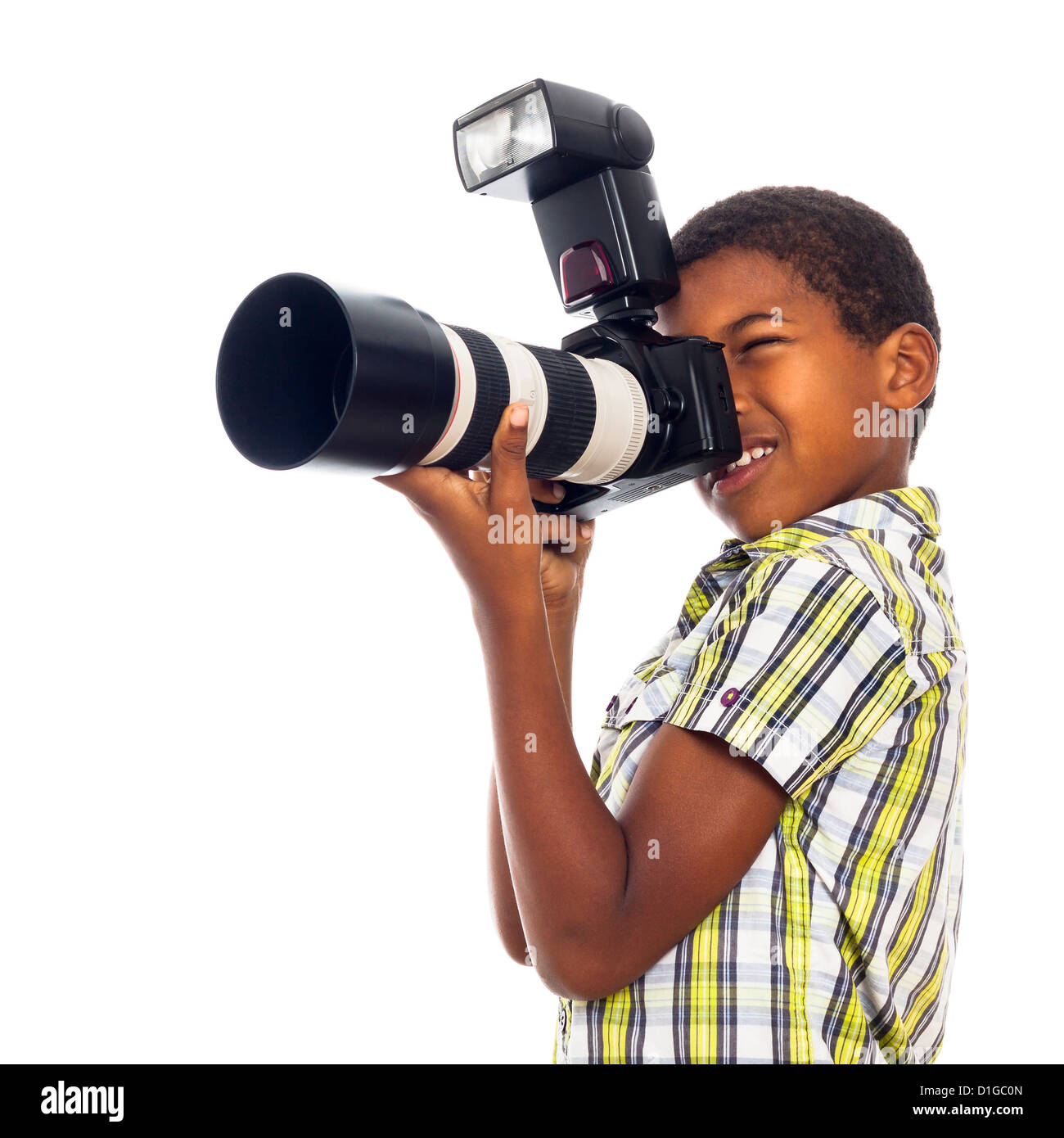 Child school boy taking photos with professional camera, isolated on white background. - Stock Image