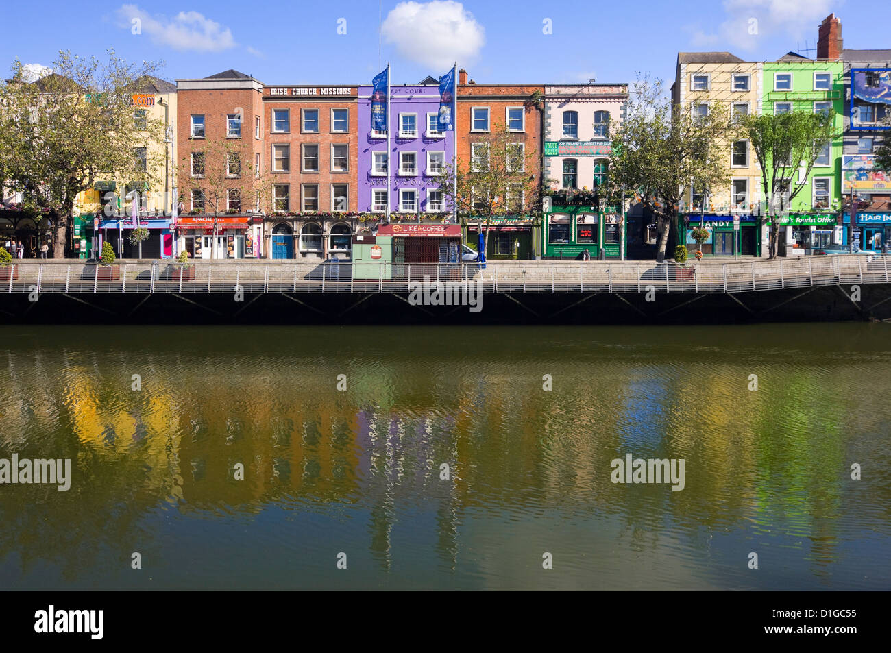 Horizontal view of the colourful buildings along Batchelor's Walk reflected in the River Liffey in Dublin on a sunny Stock Photo