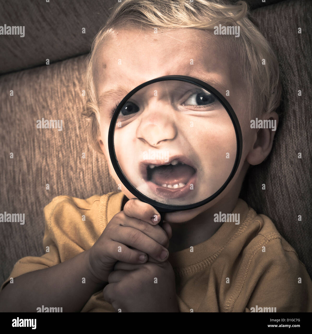 Close up of scary horror child boy face. - Stock Image