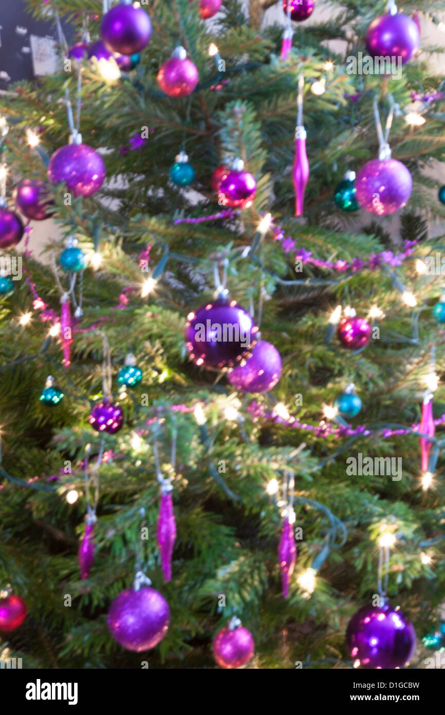 Blurred out of focus Christmas tree lights and baubles, abstract twinkling lights background. Stock Photo