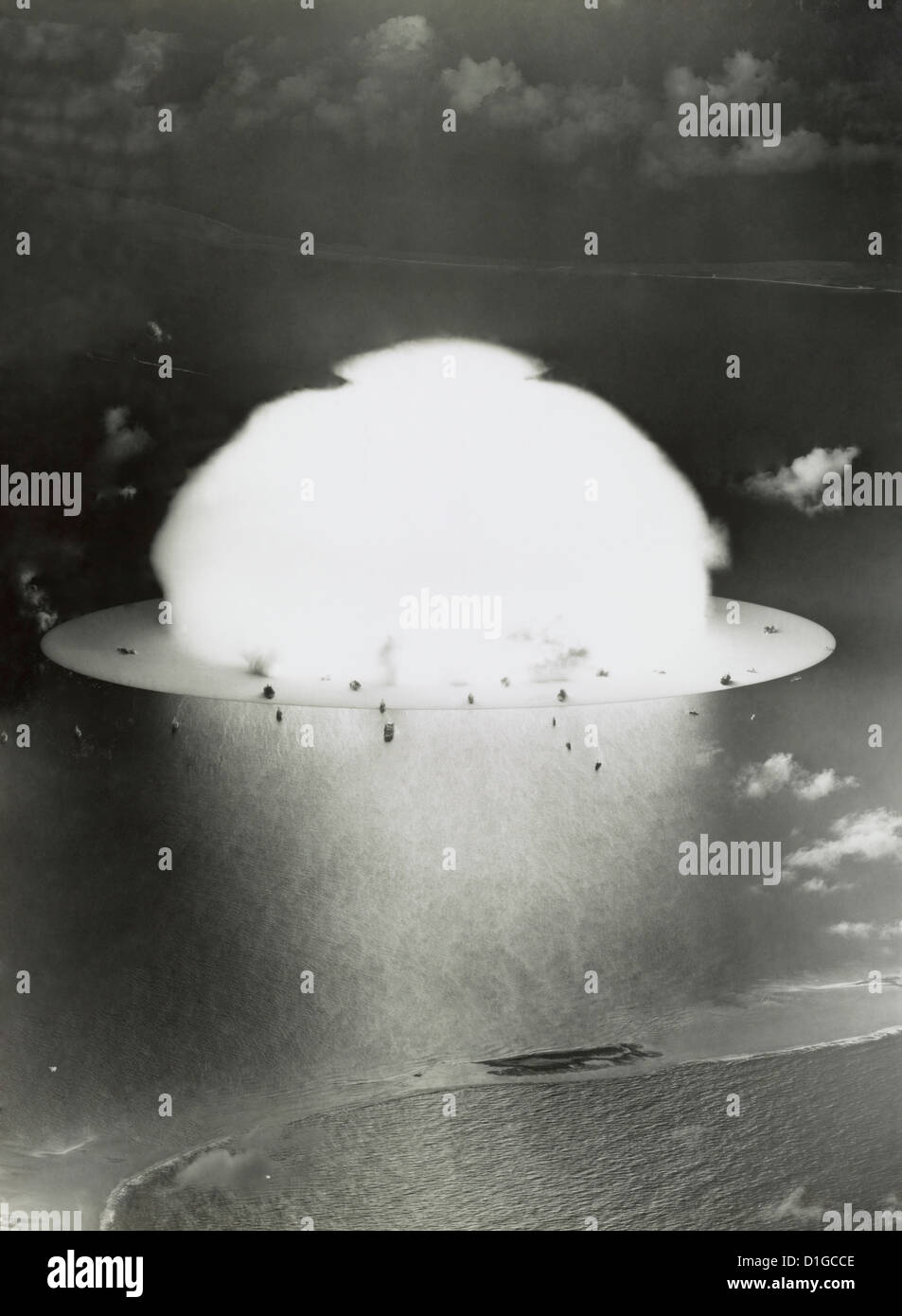 Aerial of the mushroom cloud and ships after the explosion during Operation Crossroads nuclear weapons test on Bikini - Stock Image