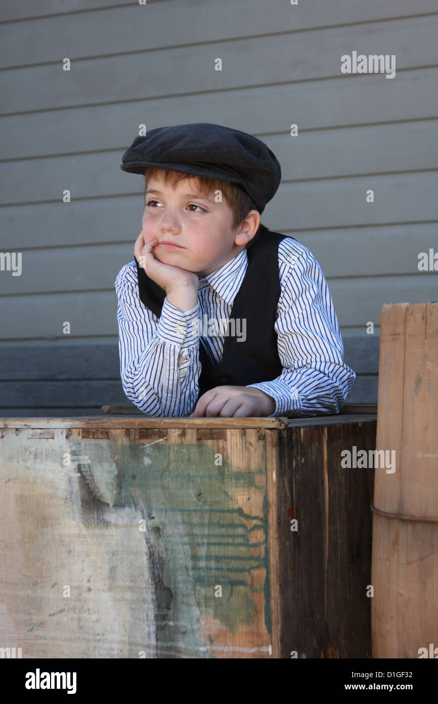 An old fashioned boy on a train depot platform - Stock Image