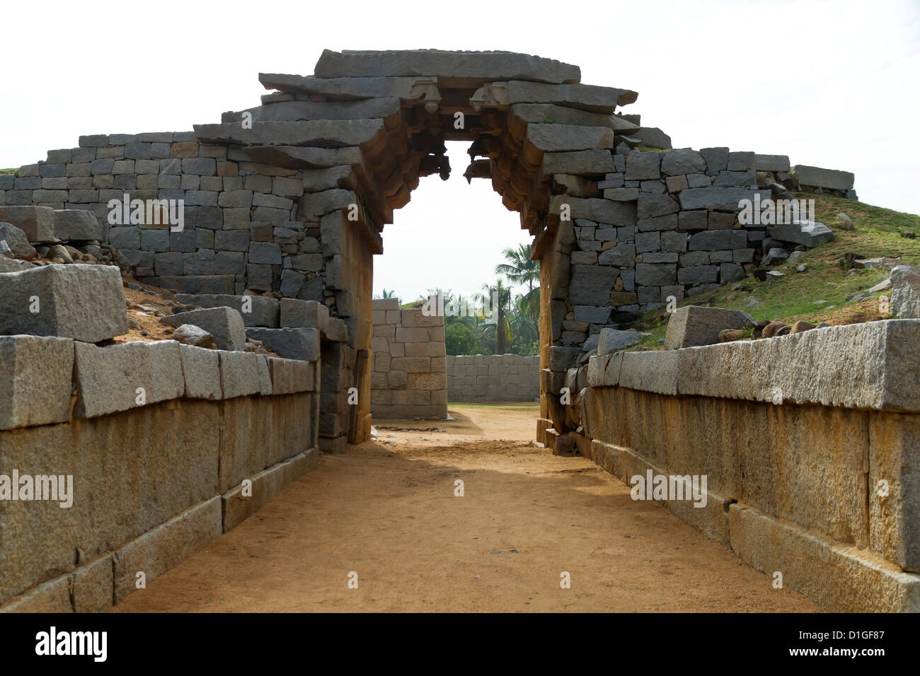 A classic example of the Vijayanagara military architecture, Bhima's gate is located in Hampi, India - Stock Image