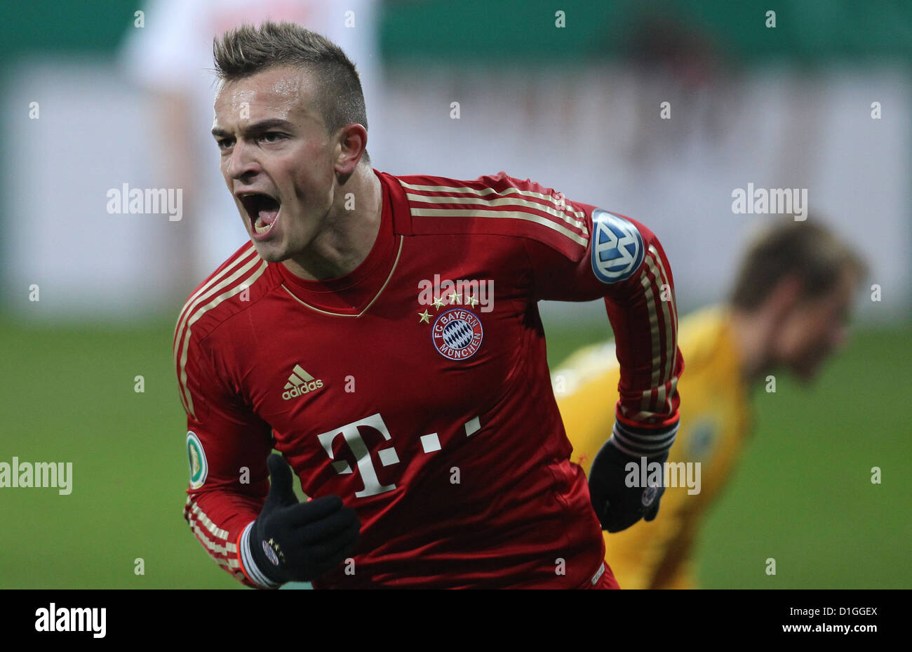 Munich's Xherdan Shaqiri celebrates his 0-2 goal during the round of the last 16 DFB Cup match between FC Augsbirg - Stock Image