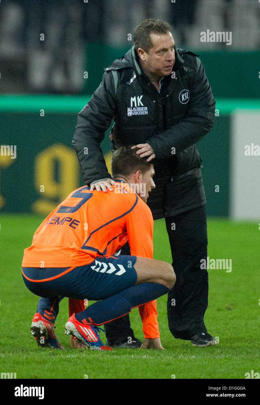 Karlsruhe's head coach Markus Kauczinski talks to his player Dennis Krempe after the DFB Cup round of sixteen - Stock Image